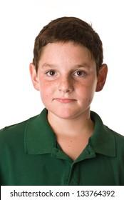 Young boy wearing a green polo shirt
