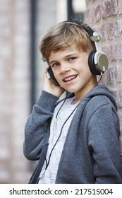 Young boy wearing headphones, close up