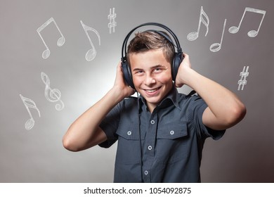 Young Boy wearing headphones, listening a music and singing. Music notes in background