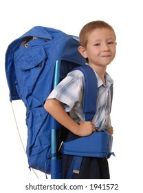 Young boy wearing a large backpack