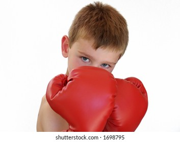 young boy wearing red boxing gloves