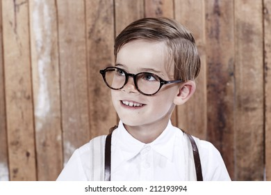 Young boy wearing spectacles, looking away