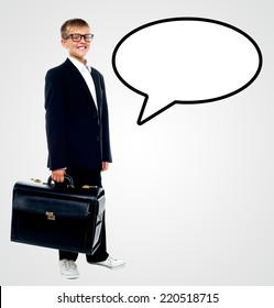 Young boy wearing suit with briefcase and speech bubble