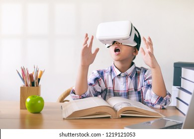 Young boy wearing a VR headset experiencing the frist time watched virtual reality. Education and innovation technology concept.