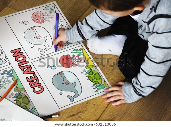 Young boy working on drawing pad network graphic overlay