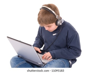 young boy working on laptop with headset