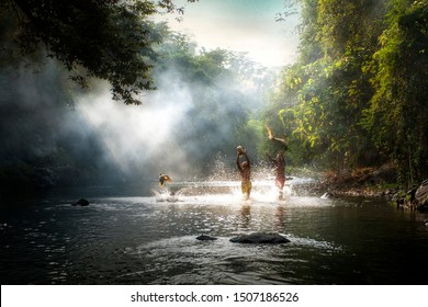 Young boys catching duck at beautiful river in Bogor West Java Indonesia. 04 08 2019