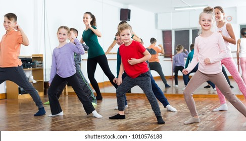 Young boys and girls studying contemp dance in dancing studio