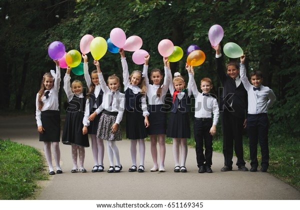 young boys and girls in uniform outdoors