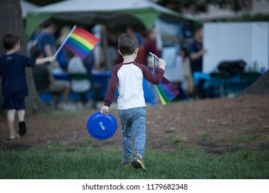Young boys holding LGBT raimbow flag