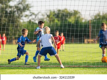 Young boys play football match