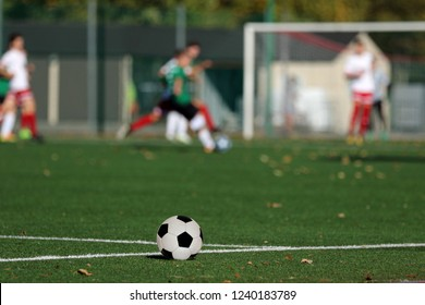Young boys playing a football match and empty space for text