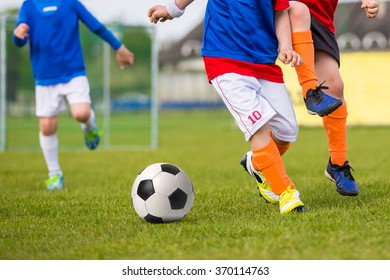 Young Boys Playing Soccer Football Match. Football soccer training match for young boys.