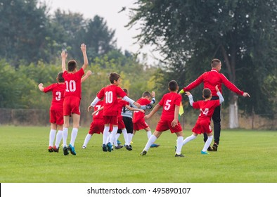 Young boys preparing for football soccer match on sports field