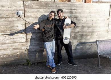 young boys skateboarders takes a selfie outdoor