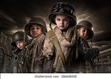 Young boys in soldier uniform in a war zone