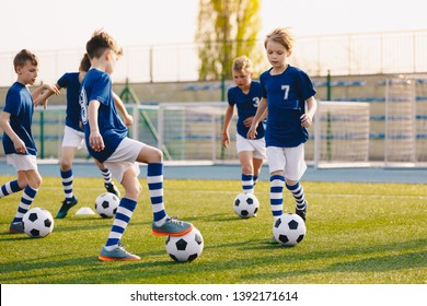 Young Boys of Sports Club on Soccer Football Training. Kids Improving Soccer Skills on Natural Turf Grass Pitch. Football Practice Session for Children Youth Team of Professional School Soccer Club