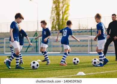 Young Boys in Sports Club on Soccer Football Training. Kids Enhance Soccer Skills on Natural Turf Grass Pitch. Football Practice Session for Children Youth Team of Professional School Soccer Club