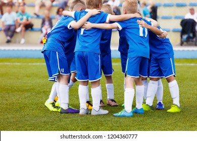 Young boys sports team on stadium. Football players in sportswear motivating before the match. Youth soccer tournament game for kids