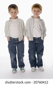 Young boys standing together isolated on white background