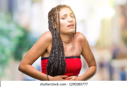 Young braided hair african american with pigmentation blemish birth mark over isolated background with hand on stomach because indigestion, painful illness feeling unwell. Ache concept.