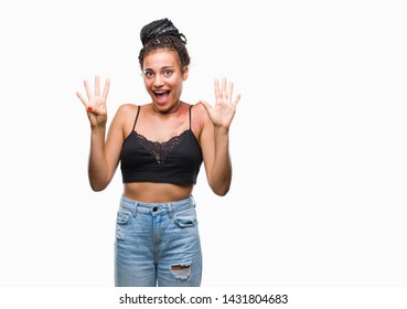 Young braided hair african american with pigmentation blemish birth mark over isolated background showing and pointing up with fingers number nine while smiling confident and happy.