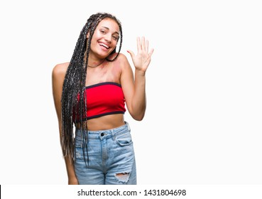 Young braided hair african american with pigmentation blemish birth mark over isolated background showing and pointing up with fingers number five while smiling confident and happy.