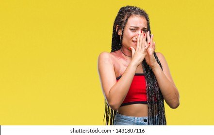 Young braided hair african american with pigmentation blemish birth mark over isolated background smelling something stinky and disgusting, intolerable smell, holding breath with fingers on nose. Bad