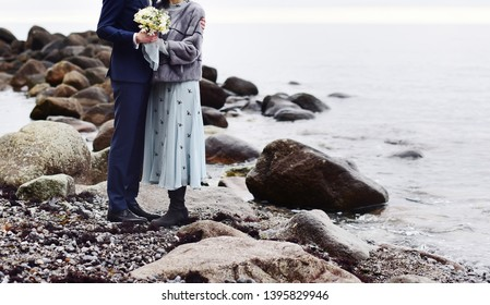 Young bridal couple posing together.