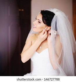young bride is getting ready at home, wedding day