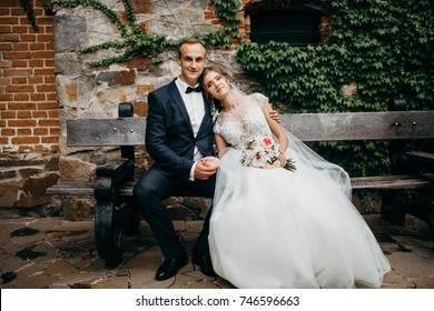 Young bride and groom in the castle in the summer
