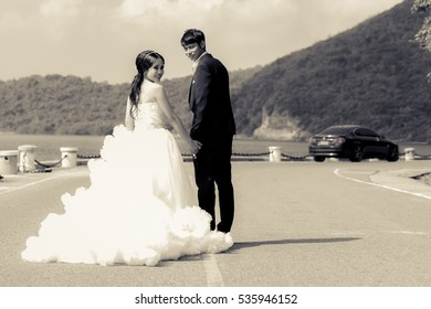 young bride and groom on the road