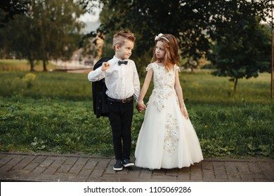 Young bride and groom playing wedding summer outdoor. Children wedding