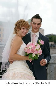 Young  Bride And Groom posing together