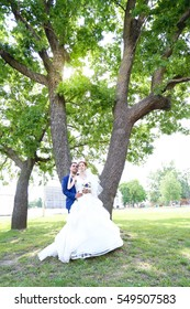 Young bride and groom walk in nature on the wedding day