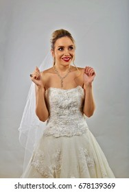 Young bride is happy about the day of her marriage.