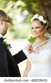 Young bride looking in to her groom's eyes filled with love