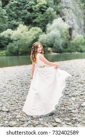 Young bride on the river bank