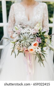 Young bride in rustic style at summer