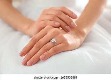 Young bride wearing beautiful engagement ring, closeup