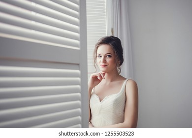 Young bride in wedding dress in room. studio shot