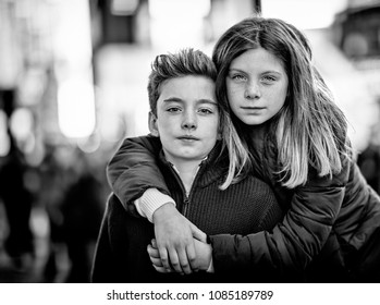 Young brother and sister embrace