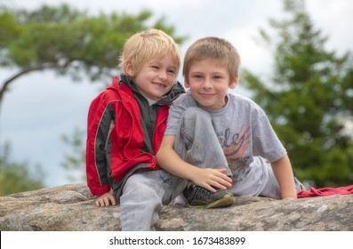 young brothers happy together on a mountaintop
