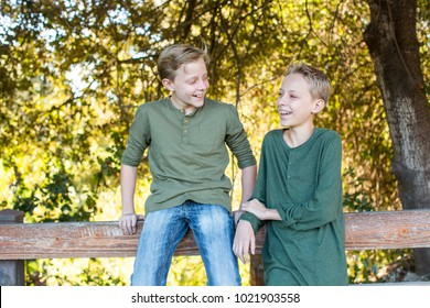 Young brothers playing together outside