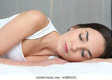 Young brown-haired woman asleep