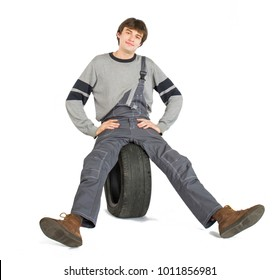 A young brunet foreman in working grey uniform with black wheel.