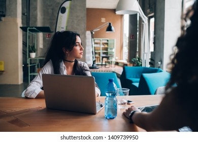 young brunette businesswoman having meeting in modern loft– emancipation, concentration, dedication