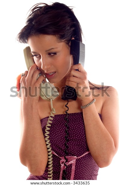 Young brunette girl eating a apple and making a call phone