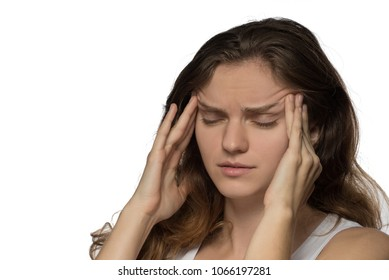 Young brunette girl experiencing headache or depression and mourned over white background