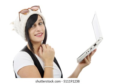 young brunette girl with a laptop isolated on white background